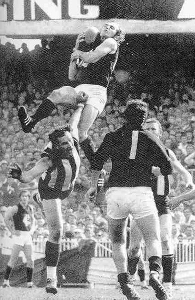 Alex Jesaulenko takes a Mark of the Year (1970).